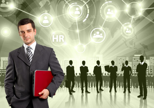 business man standing in front of graphics of other businessmen