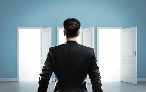 man standing in front of three open doors