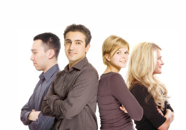 young business people folding arms and smiling
