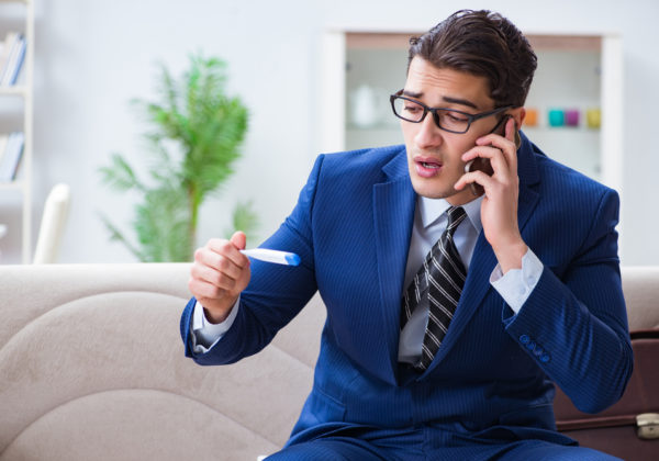 man wearing a navy suit on the phone