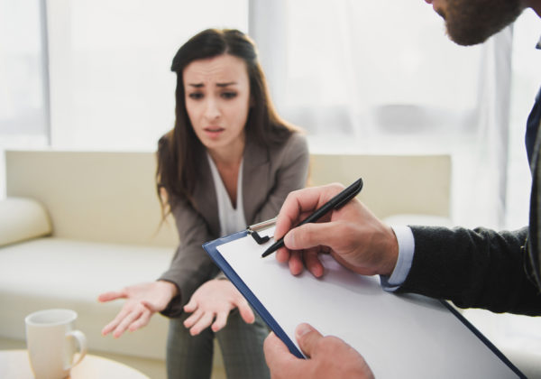 frustrated woman talking to hr representative