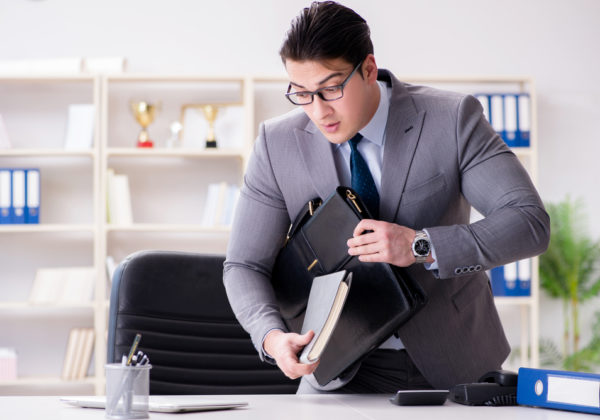 young businessman sitting at desk for work