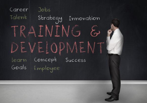 training and devlopment written on a chalk board
