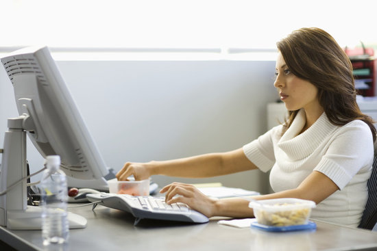 woman with lunch at her work desk