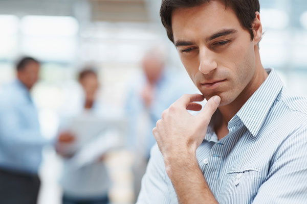 man thinking near other business people