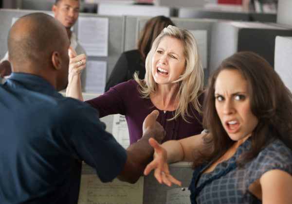 frustrated employees arguing at a cubicle